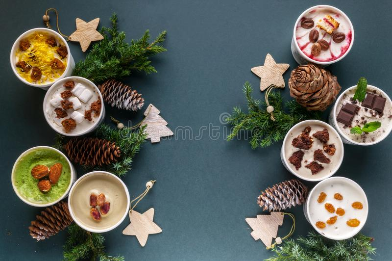 Assorted of Italian ice cream in paper cups on Christmas background. Delicious sweet dessert. Top view stock images
