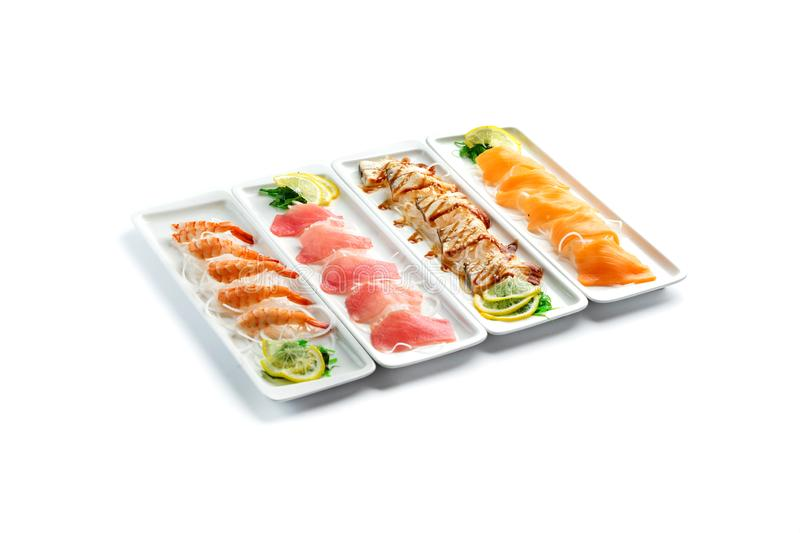 Assorted japanese food dishes on  plates on an isolated white background stock photos
