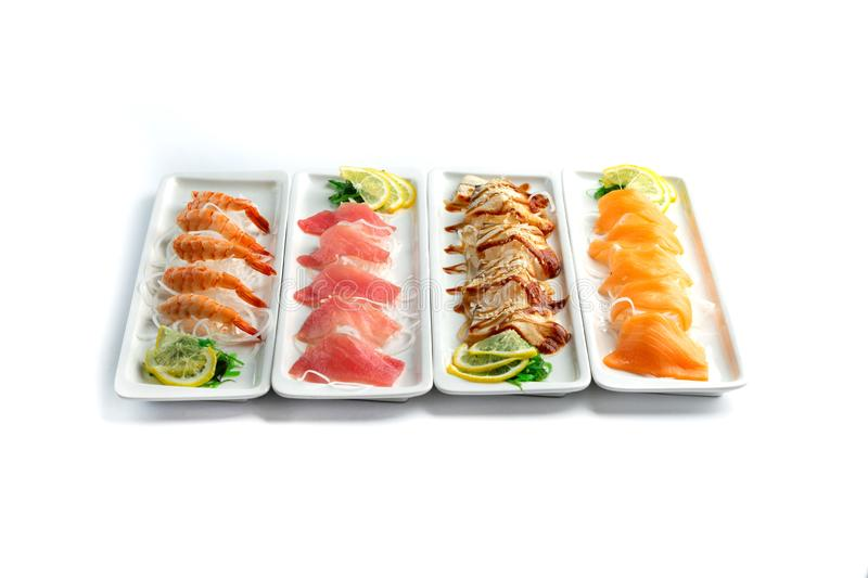Assorted japanese food dishes on  plates on an isolated white background. Assorted japanese food dishes on a white rectangular  plates on an isolated white royalty free stock photos