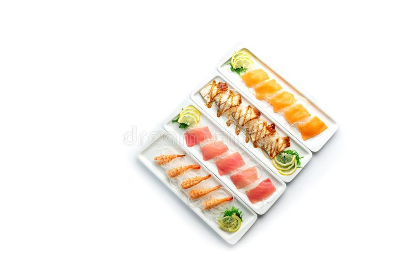 Assorted japanese food dishes on  plates on an isolated white background. Assorted japanese food dishes on a white rectangular plates on an isolated white royalty free stock image