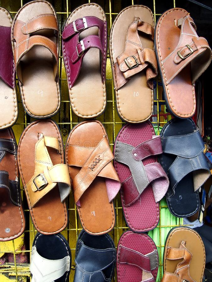 Assorted leather slippers on display stock image