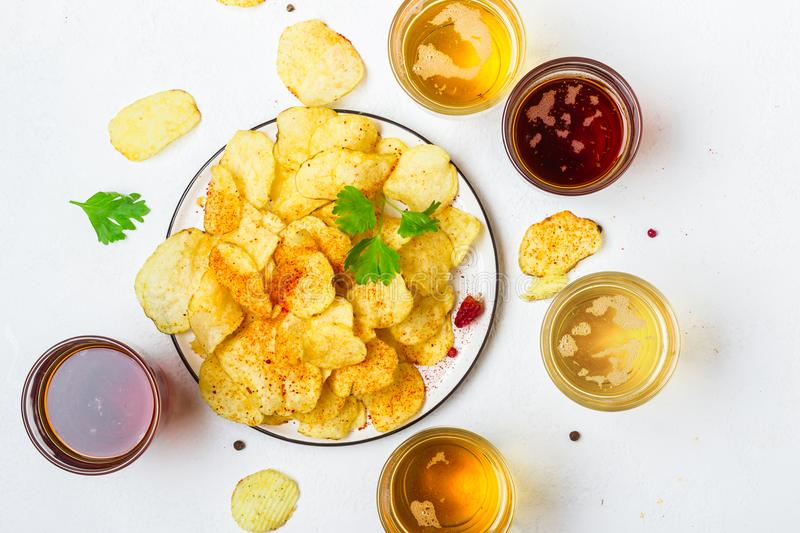 Assorted light and dark Beers and chips.  stock photography
