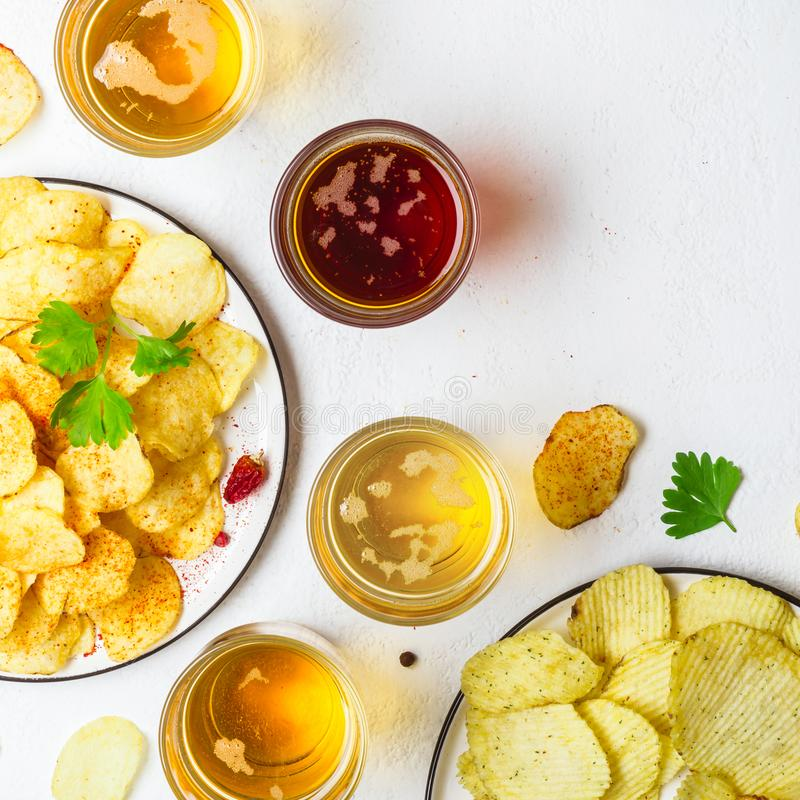 Assorted light and dark Beers and chips.  royalty free stock images