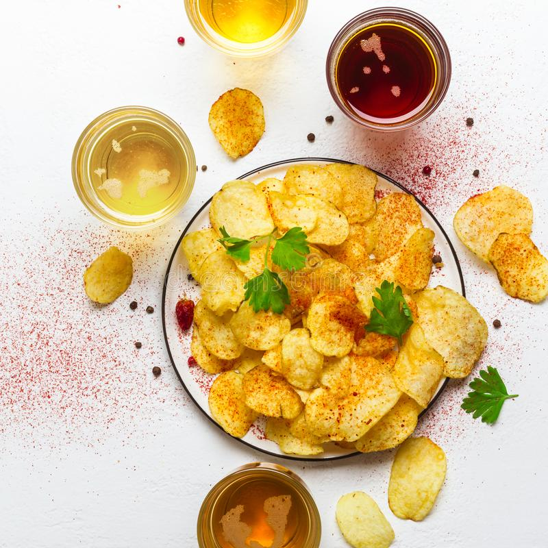 Assorted light and dark Beers and chips.  stock images