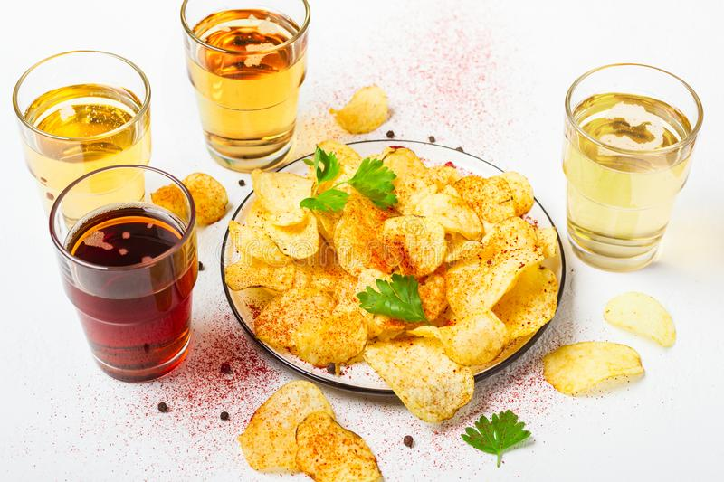Assorted light and dark Beers and chips.  royalty free stock photos