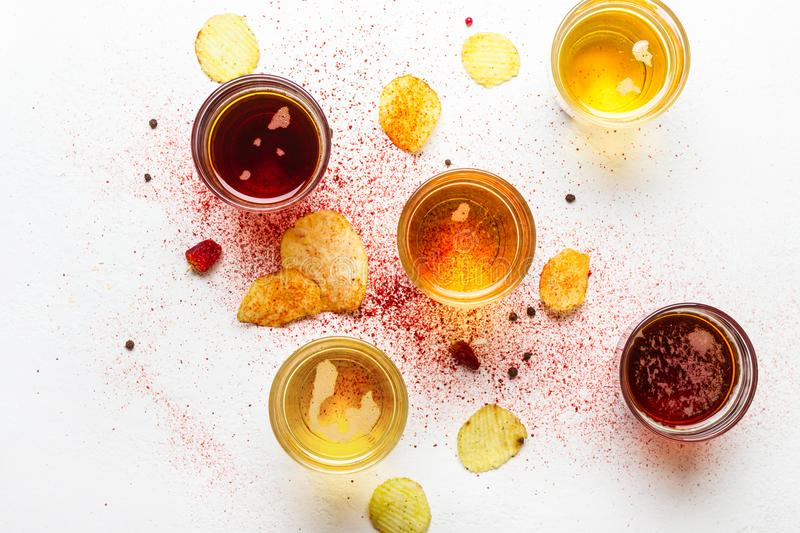 Assorted light and dark Beers and chips. Food abstract background royalty free stock photography
