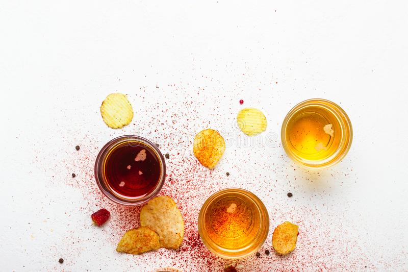Assorted light and dark Beers and chips. Food abstract background stock photo