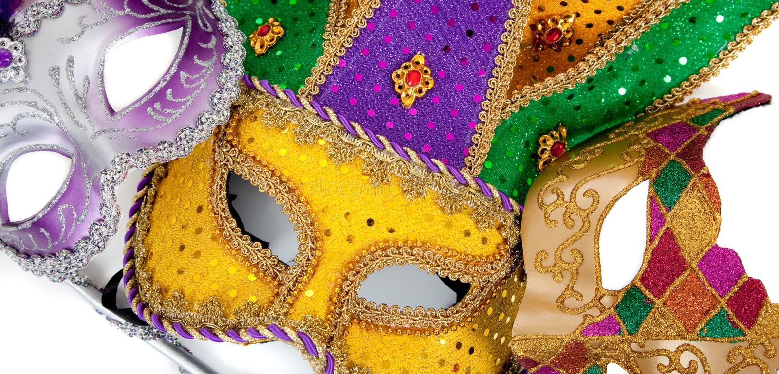 Assorted mardi gra masks on white. Assorted mardi gra masks including gold, purple and green on a white background stock photos