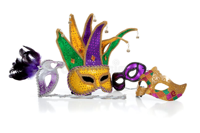 Assorted mardi gra masks on white. Assorted mardi gra masks including gold, purple and green on a white background royalty free stock photos