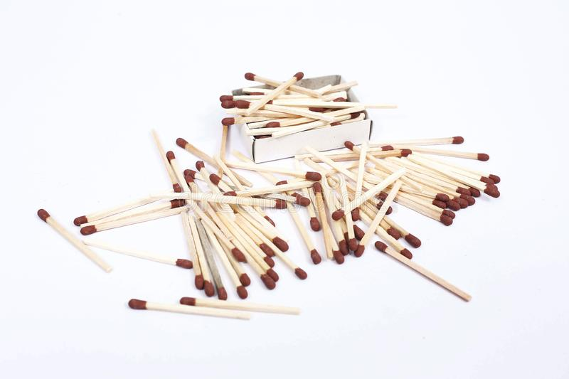 Assorted matchsticks with match box. Isolated on the white background royalty free stock image