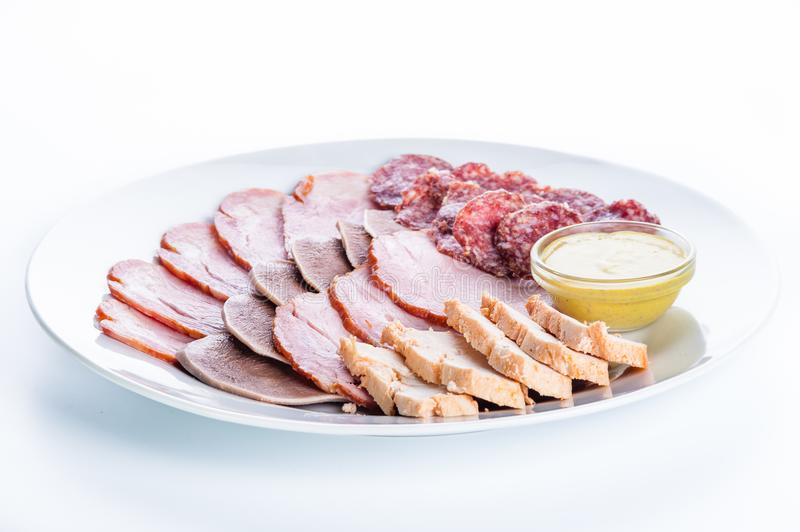 Assorted meat: ham, smoked sausage, salami, chicken, tongue and stock image