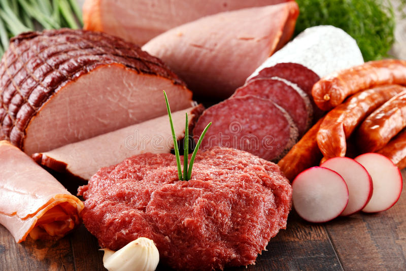 Assorted meat products including ham and sausages.  stock photo