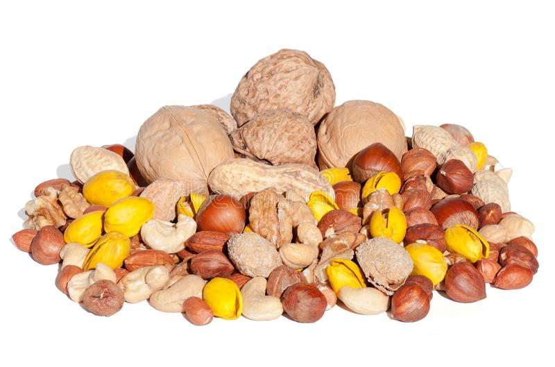 Assorted mixed nuts isolated on white background. stock images