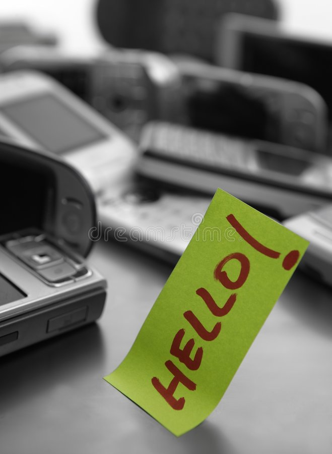 Assorted mobile phones and written word: HELLO stock photos
