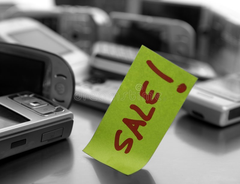 Assorted mobile phones and written word: SALE stock photos