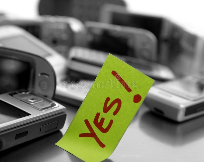 Assorted mobile phones and written word: YES royalty free stock images