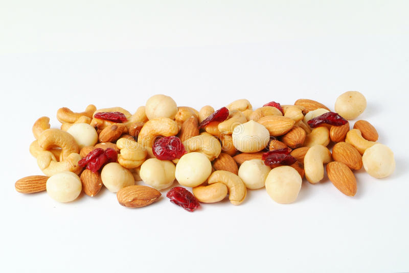Assorted nuts. Pile of assorted nuts isolated on white background stock images