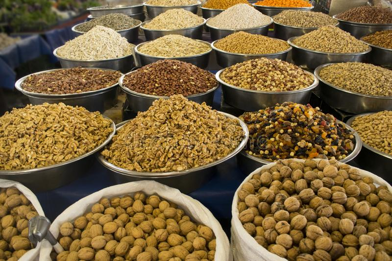 Assorted nuts almond, hazelnut, cashew, pistachio, chickpea, walnut, peanut, sunflower seeds in bowls at farmers market royalty free stock photo