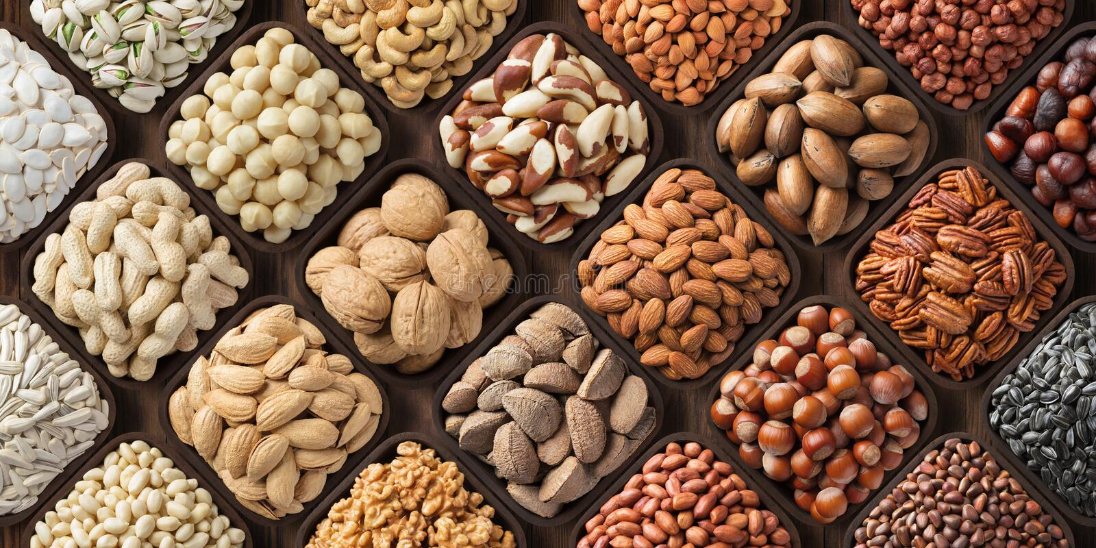 Assorted nuts background, large mix seeds. raw food products: pecan, hazelnuts, walnuts, pistachios, almonds, macadamia, cashew, stock images