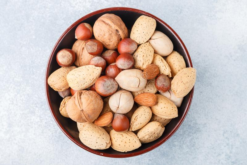 Assorted nuts in the peel. Almonds, hazelnuts, pecans, walnuts. Gourmet snack. Healthy food. Selective focus stock image