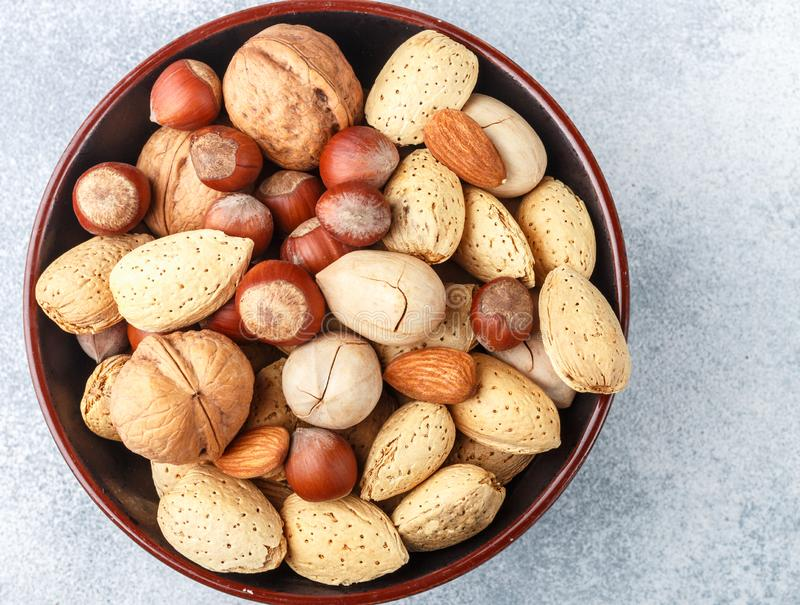 Assorted nuts in the peel. Almonds, hazelnuts, pecans, walnuts. Gourmet snack. Healthy food. Selective focus stock photos