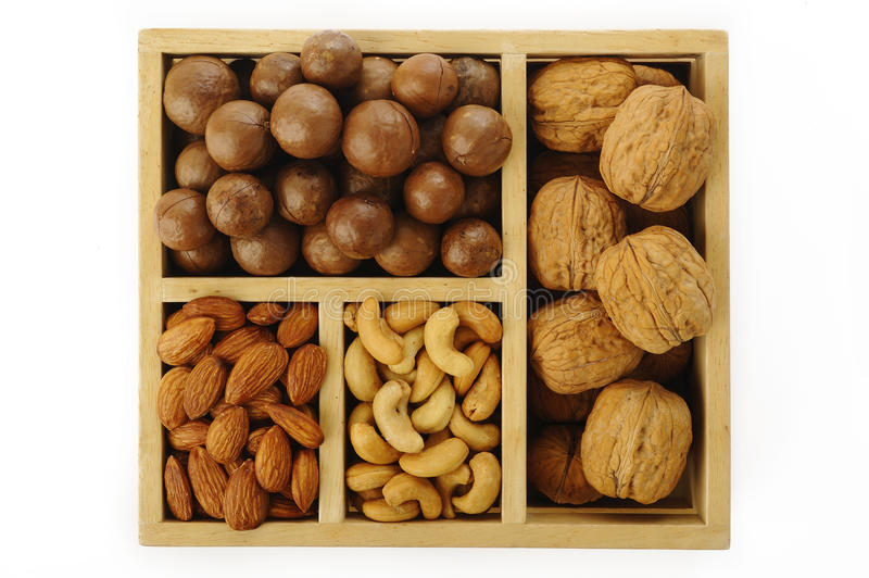 Assorted nuts. In wooden box royalty free stock photos