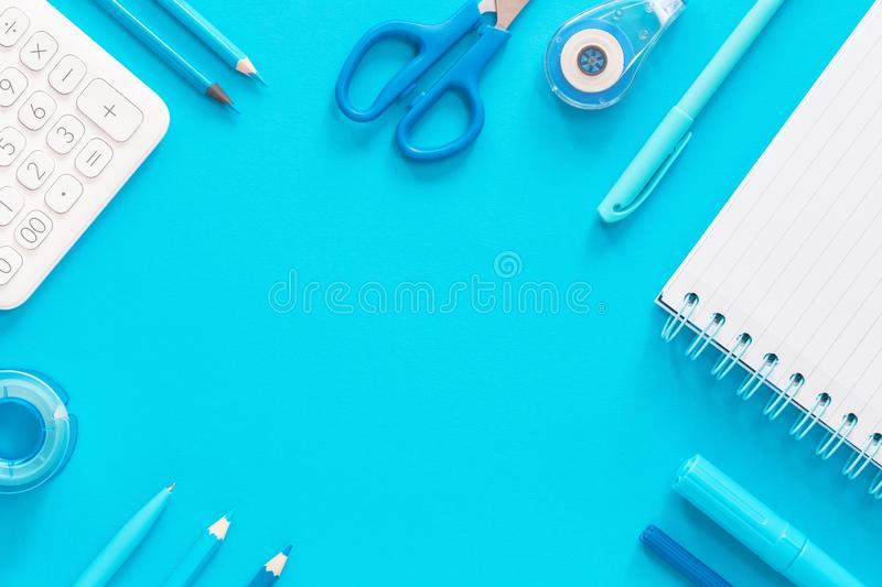 Assorted office and school white and blue stationery royalty free stock photos
