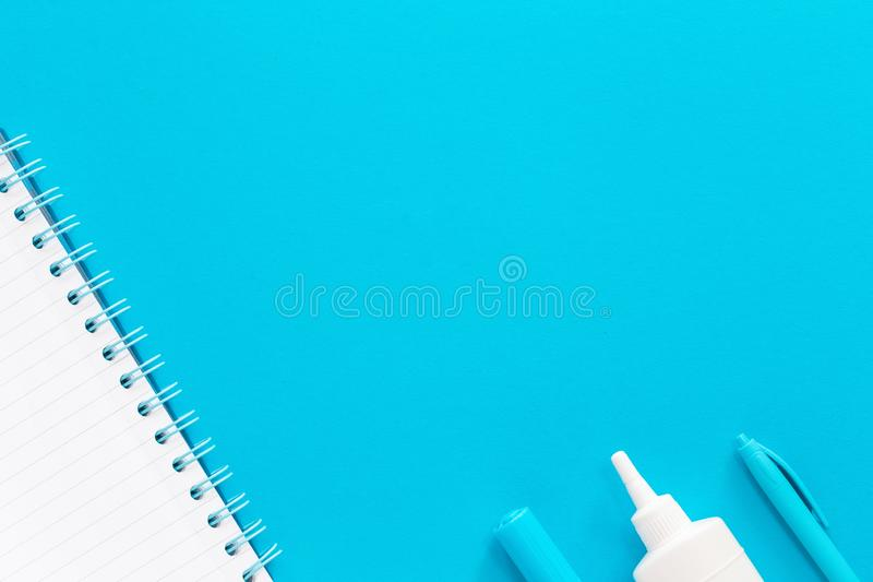 Assorted office and school white and blue stationery stock photography