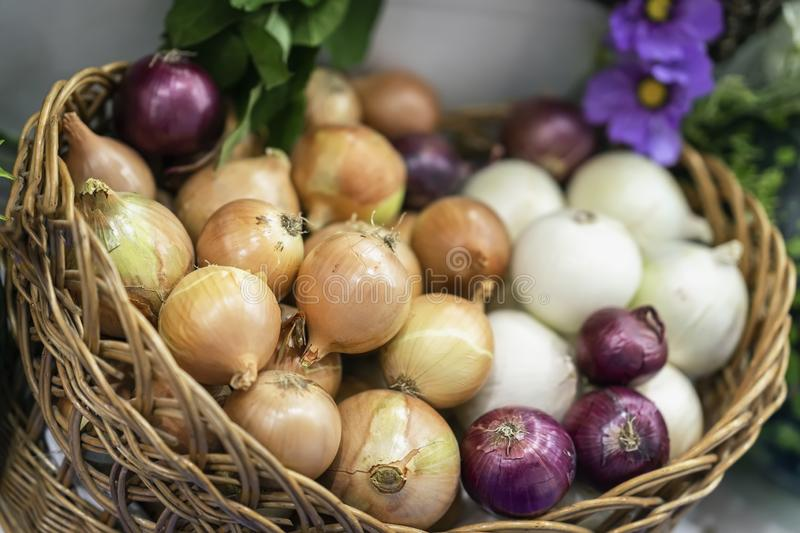 Assorted onions of different varieties. Basket with fresh organic vegetables, Live vitamins, selectiv focus. Farmers stock images