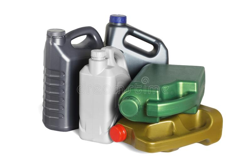 Assorted Plastic Containers for Engine Oils royalty free stock image