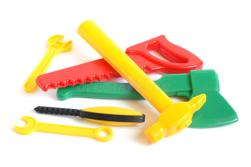 Assorted plastic toy tools. On a white background stock photo