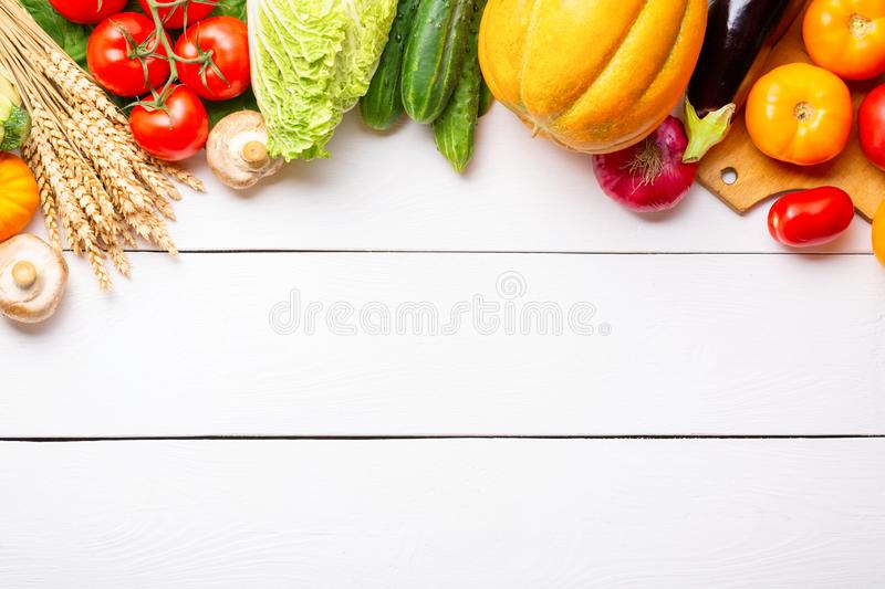 Assorted raw organic fresh vegetables on white wooden table. Fresh garden vegetarian food. Autumn seasonal image of farmer table stock photography