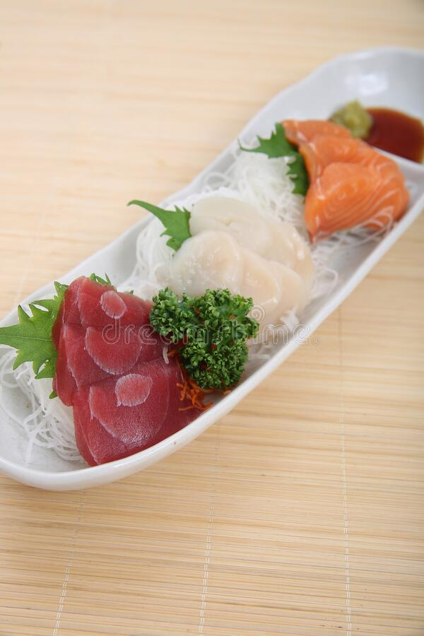A plate of assorted sashimi. Assorted salmon, tuna, scallop sashimi made sell well as snacks of the Japanese food stock images