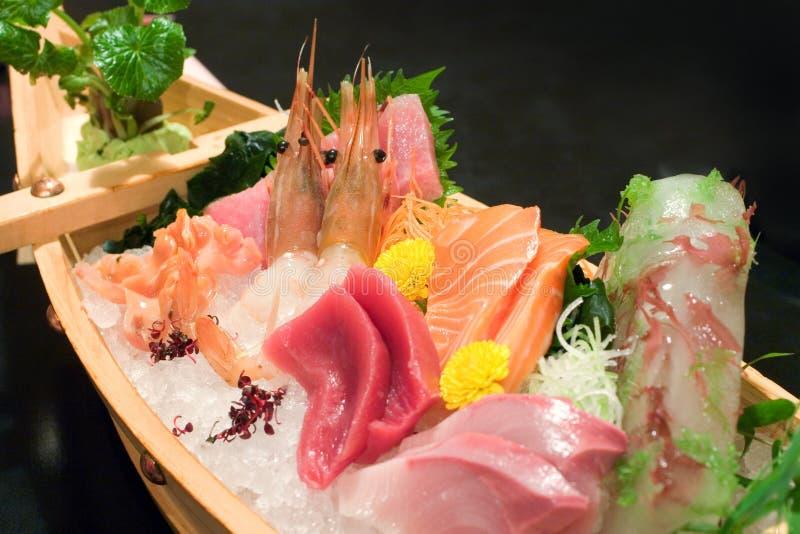 Assorted sashimi boat. Japanese assorted sashimi boat packed on crushed ice stock photos