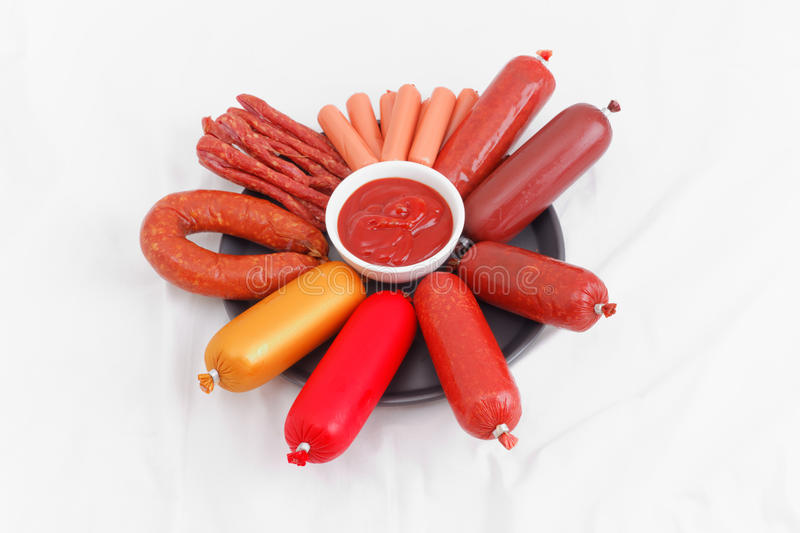 Assorted sausages on a plate royalty free stock photography