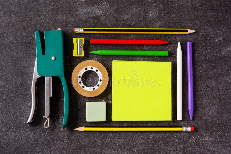Assorted of school supplies on black slate. Back to school concept. royalty free stock photo