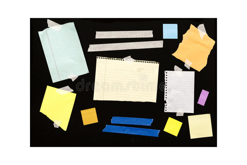 Assorted Scrap Paper On Black Board stock photography