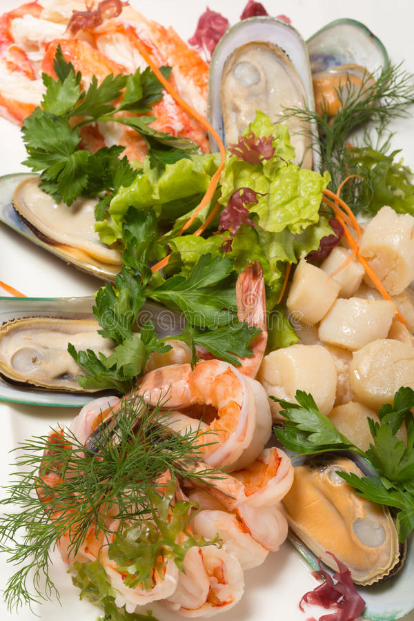 Assorted sea scallops, crab, mussels, tiger shrimp stock photos