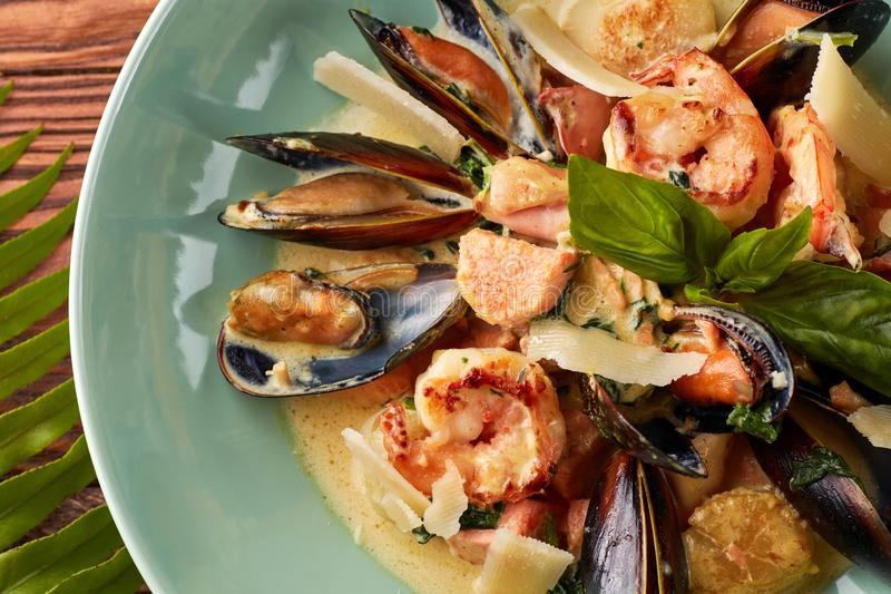 Assorted seafood with creamy sauce and parmesan stock photography