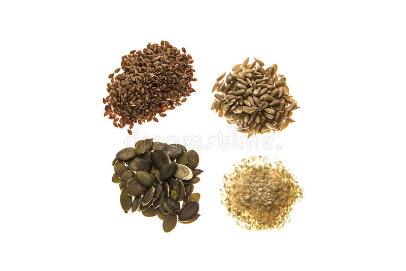 Assorted seeds on a white background royalty free stock image