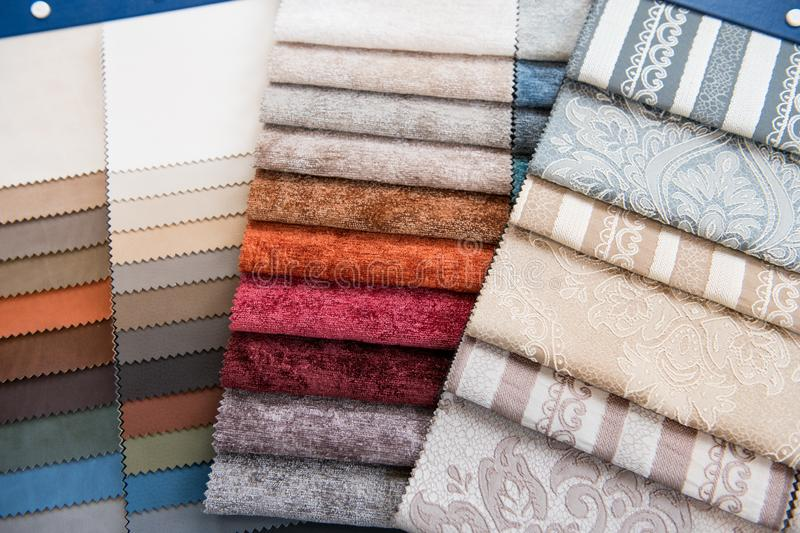 Assorted selection of fabric color swatches stock images