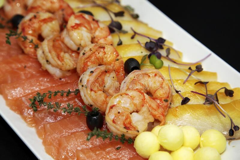 Assorted shrimp, trout and oily fish royalty free stock images