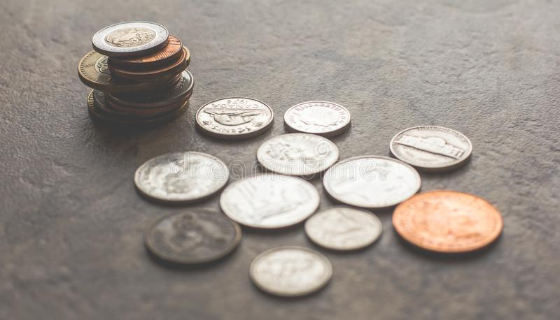 Assorted Silver-and-gold-colored Coins on Gray Surface royalty free stock photography