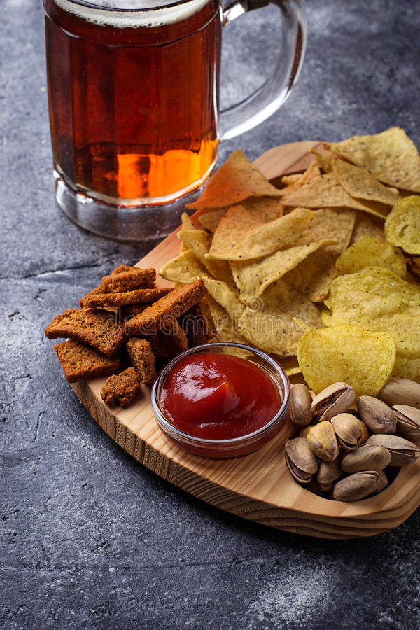 Assorted of snack. Chips, pistachios, nachos and peanuts. Selective focus stock images