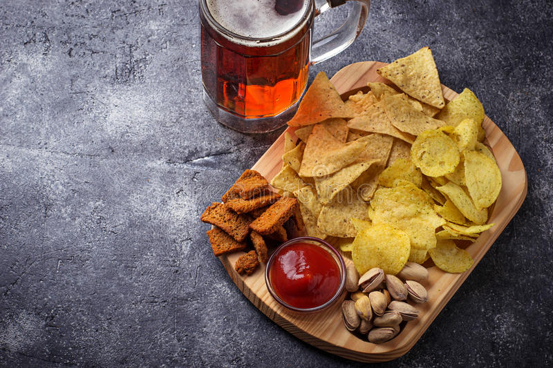 Assorted of snack. Chips, pistachios, nachos and peanuts. Selective focus royalty free stock images