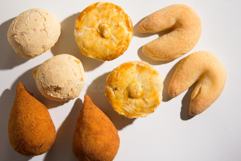 Assorted snacks: Pao de Queijo, Chipa, Coxinha and Empada. Group. Assorted snacks: Pao de Queijo also known as Pandebono, Chipa, Coxinha and Empada. Group of royalty free stock image