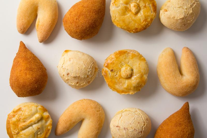 Assorted snacks: Pao de Queijo, Chipa, Coxinha and Empada. Group. Assorted snacks: Pao de Queijo also known as Pandebono, Chipa, Coxinha and Empada. Group of stock photography