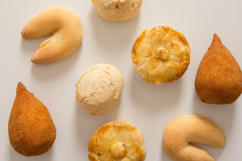 Assorted snacks: Pao de Queijo, Chipa, Coxinha and Empada. Group. Assorted snacks: Pao de Queijo also known as Pandebono, Chipa, Coxinha and Empada. Group of stock photo