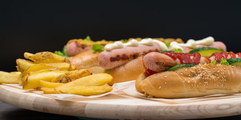 Assorted speciality hot dogs with potato chips royalty free stock image