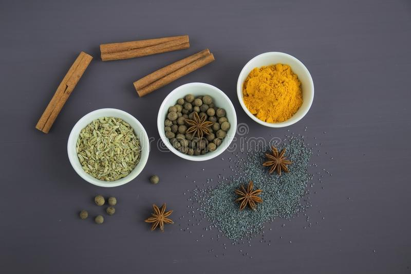 Assorted Spices Near White Ceramic Bowls royalty free stock image